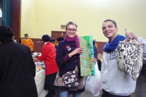 Figure 10: Igshaan Adams and Jenny Parsons with church bazaar purchases, Jenny with Brian's painting