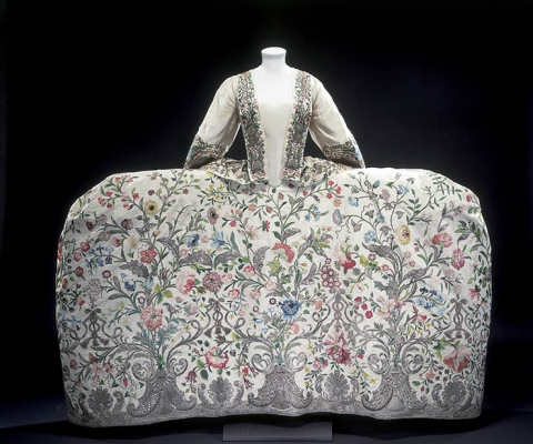 Fig. 1 - Silk court mantua, c. 1740–45, embroidered with colour silk and silver thread (probably made in England). London, Victoria and Albert Museum, T.260&A-1969. The style of the dress echoes seventeenth-century elite fashions, rather than those of the eighteenth century.