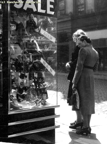 Image 11. Window gazers at the summer sales, July 1939