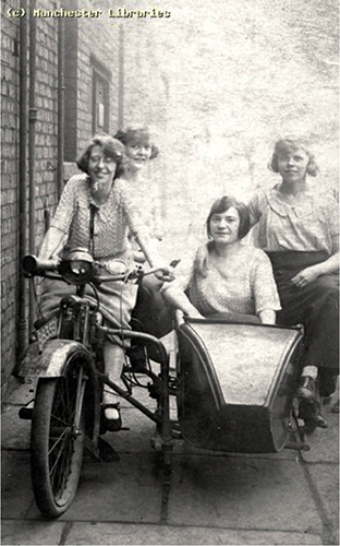 Fig. 2. Emily Lee seated on her father's motorbike and friends, 1933