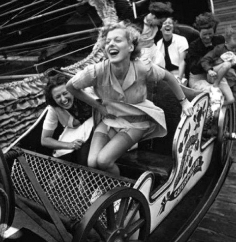 Fig. 3. 'Crises forgotten. Private worries left at the top of the incline.' Young women enjoying a rare day out at the fun-fair, Southend Fair, Essex.1938. Picture Post newspaper, 'Month of Fairs' October 8th 1938