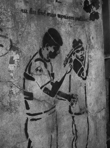 "Figure 2: Stencil art of police interrogation of Kova M youth. Kriolu caption reads: ""We don't want anymore oppressive police"""