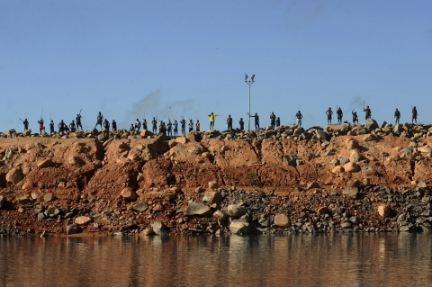 Figure I – A group of Amazon Indians protests on an earth barrier that is part of the construction of the massive Belo Monte hydroelectric