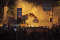 Besiktas football team supporter club Carşı members hijacked a bulldozer and chased police vehicles during Gezi protests, 30 December 2013.