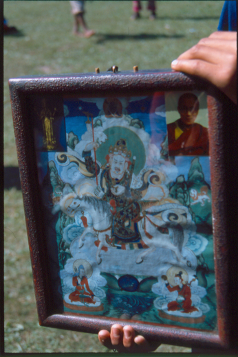 Fig. 11. A depiction of Dayan Deerh with photos of Avalotikeçvara bodhisattva and the 14th Dalai lama