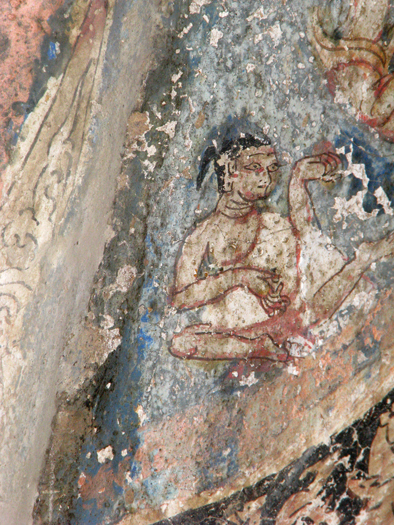 Fig. 31. Youthful figure (Sudhana ?) with a ponytail on the Maitreya sculpture dhotī