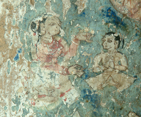 Fig. 33. Youthful figure (Sudhana ?) with a ponytail attending a laywoman on the Maitreya sculpture dhotī
