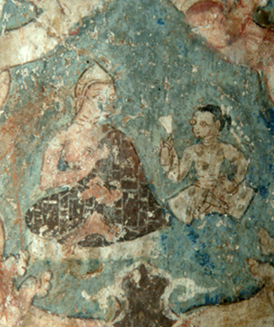 Fig. 34. Youthful figure (Sudhana ?) attending a monk on the Maitreya sculpture dhotī