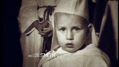 4. Young boy in Ku Klux Klan attire