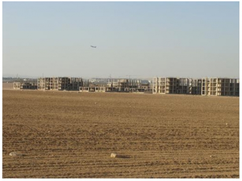 Figure 3. The low-income housing project at al Jizza. The building of the newly construction international airport are in the background