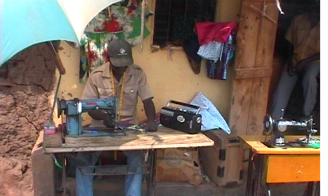 Figure 2. An informal worker in Uganda listening to business information and advice via the radio broadcast.
