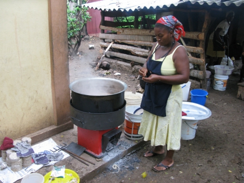 Figure 3. Fuel-efficient institutional stove using locally made biomass briquettes in Haiti (credit Prakti)