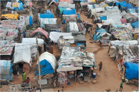 Aerial view of Vasanthnagar: Due to the temporary nature of their tenure, urban poor live in small tarpaulin sheet tent like structures which prevent them from gaining access to important infrastructure and services including electricity, basic health and sanitation -
