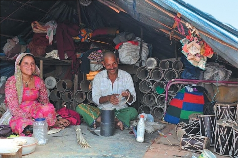 Open Tarpaulin Tents serving as living and work spaces for the Dholakwale nomadic community
