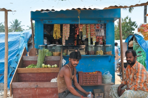 Entrepreneur Kumar at his petty shop in Kariammana Agrahara (Before IEC intervention)