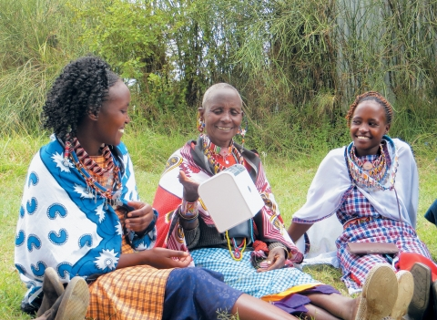 Masai women discovering solar solutions during a demonstration session, Kenya