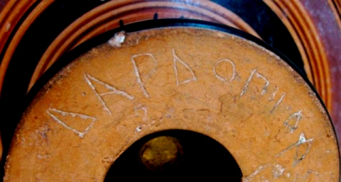 Fig. 4 - Graffito under foot of Attic black-figure kylix, c. 530-20. Web photo from auction catalogue.