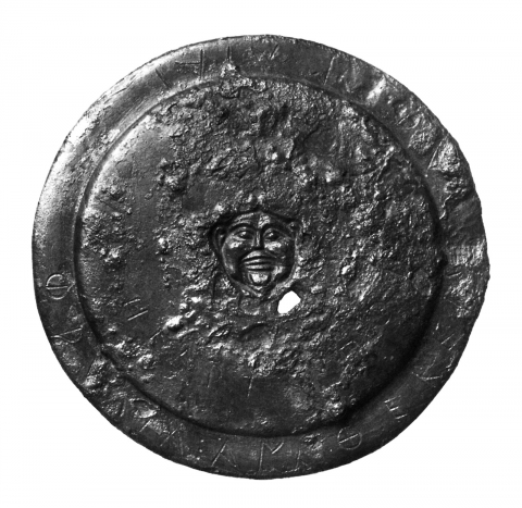 Figure 1. Bronze miniature votive shield from the Acropolis (after Scholl, 2006, p. 135, fig. 55).