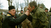 Chaplain Dmitro Povorotnyi blesses the soldiers of the