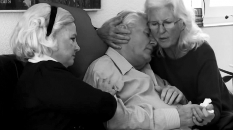 Image 2: Christine and Erika close in to hold Peter together as he begins to lose consciousness.